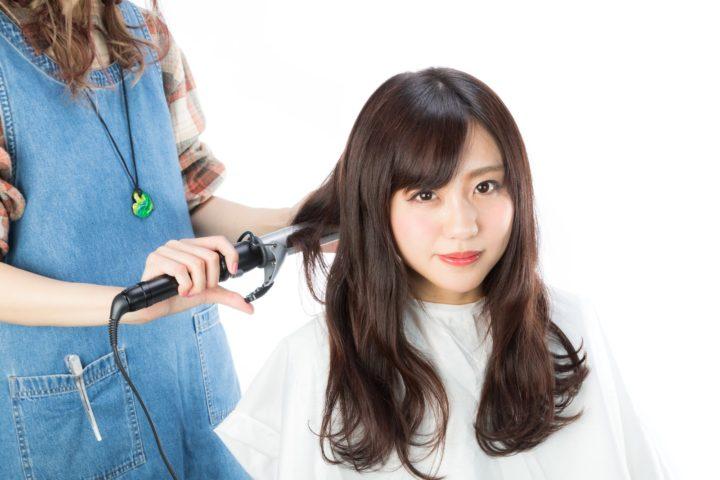 Japanese beauty standards, women curling hair in a hair salon
