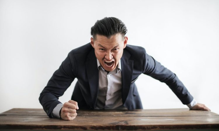 black companies in Japan, angry man with table
